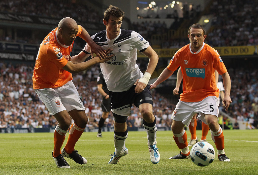 LONDON, UNITED KINGDOM - MAY 07: Gareth Bale of Spurs tries to find a way through Neal Eardley and Alex Baptiste of Blackpool during the Barclays Premier League match between Tottenham Hotspur and Blackpool at White Hart Lane on May 7, 2011 in London, England.  (Photo by Scott Heavey/Getty Images)