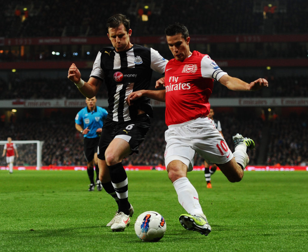 LONDON, ENGLAND - MARCH 12: Robin van Persie of Arsenal and Michael Williamson of Newcastle battle for the ball during the Barclays Premier League match between Arsenal and Newcastle United at Emirates Stadium on March 12, 2012 in London, England.  (Photo by Mike Hewitt/Getty Images)
