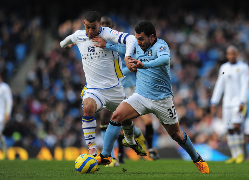 MANCHESTER, ENGLAND - FEBRUARY 17:  Lee Peltier of Leeds United battles for the ball with Carlos Tevez of Manchester City during the FA Cup with Budweiser Fifth Round match between Manchester City and Leeds United at the Etihad Stadium on February 17, 2013 in Manchester, England.  (Photo by Shaun Botterill/Getty Images)