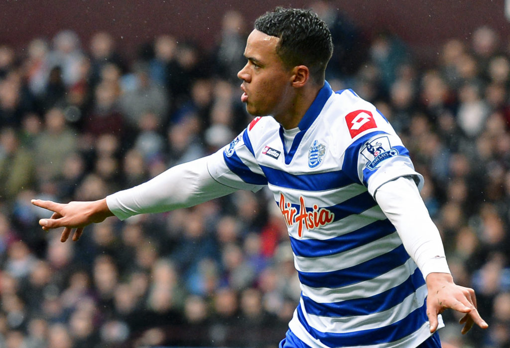 """Queens Park Rangers' English midfielder Jermaine Jenas celebrates after scoring a goal during the English Premier League football match between Aston Villa and Queens Park Rangers at Villa Park in Birmingham, central England, on March 16, 2013. AFP PHOTO/BEN STANSALL - RESTRICTED TO EDITORIAL USE. No use with unauthorized audio, video, data, fixture lists, club/league logos or """"live"""" services. Online in-match use limited to 45 images, no video emulation. No use in betting, games or single club/league/player publications.        (Photo credit should read BEN STANSALL,BEN STANSALL/AFP via Getty Images)"""