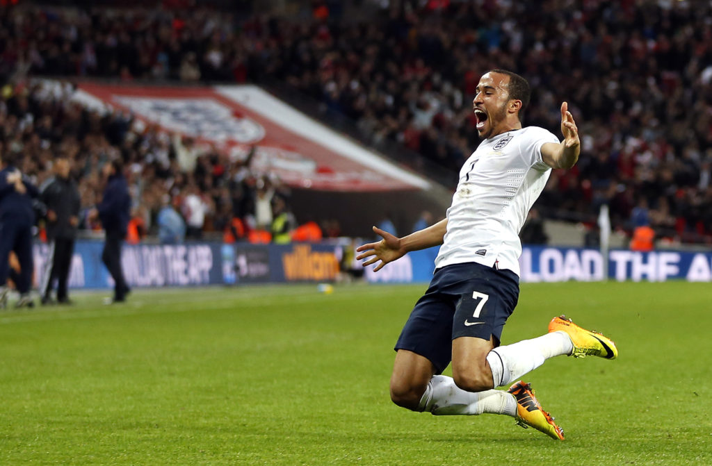 England's Andros Townsend celebrates scoring his team's third goal during the World Cup 2014 Group H Qualifying football match between England and Montenegro at Wembley Stadium in north London on October 11, 2013. AFP PHOTO/ADRIAN DENNIS  == NOT FOR MARKETING OR ADVERTISING USE / RESTRICTED TO EDITORIAL USE ==        (Photo credit should read ADRIAN DENNIS/AFP via Getty Images)