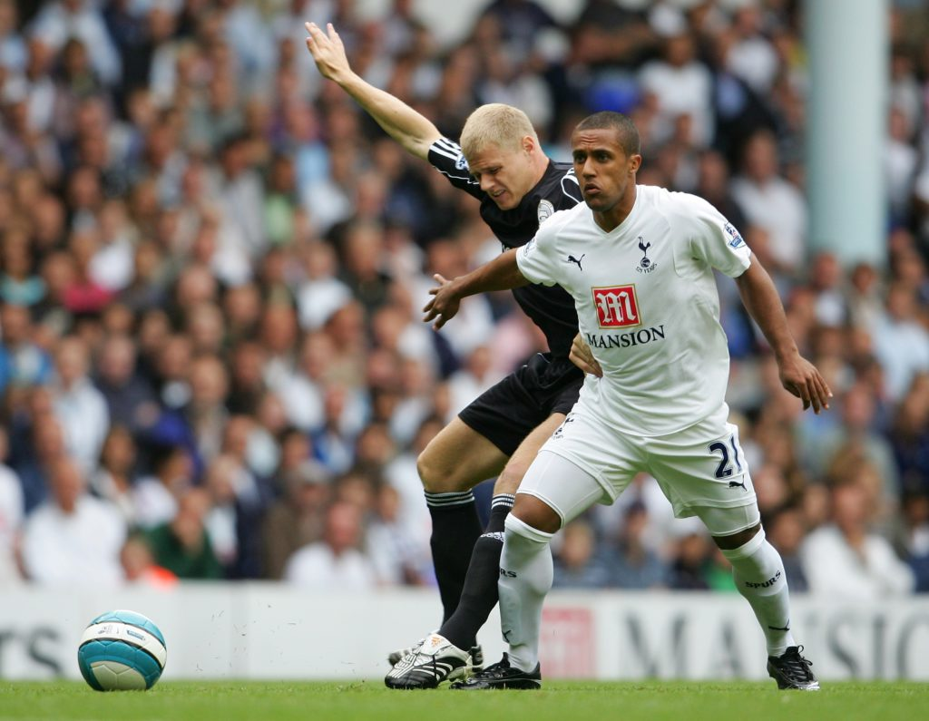 LONDON - AUGUST 18: Wayne Routledge of Tottenham holds off James McEveley of Derby during the Barclays Premier League match between Tottenham Hotspur and Derby County at White Hart Lane on August 18, 2007 in London, England.  (Photo by Jamie McDonald/Getty Images)