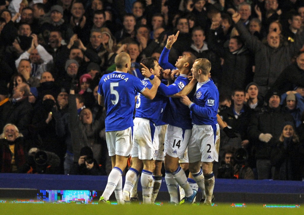 Everton's English forward James Vaughan (2nd R) celebrates his opening goal with team-mates during the English Premier League football match between Everton and Burnley at Goodison Park, Liverpool, north-west England, on December 28, 2009. AFP PHOTO/Paul Ellis  FOR EDITORIAL USE ONLY Additional licence required for any commercial/promotional use or use on TV or internet (except identical online version of newspaper) of Premier League/Football League photos. Tel DataCo +44 207 2981656. Do not alter/modify photo. (Photo credit should read PAUL ELLIS/AFP via Getty Images)